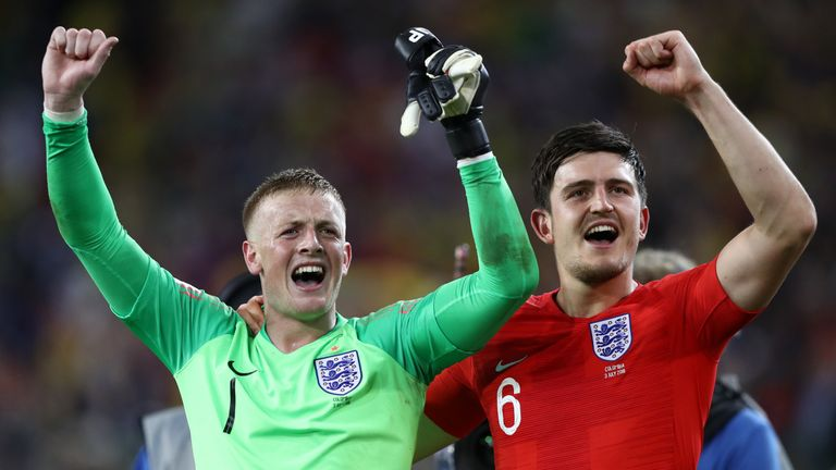 Jordan Pickford and Harry Maguire celebrate World Cup victory over Colombia on 3 July 2018