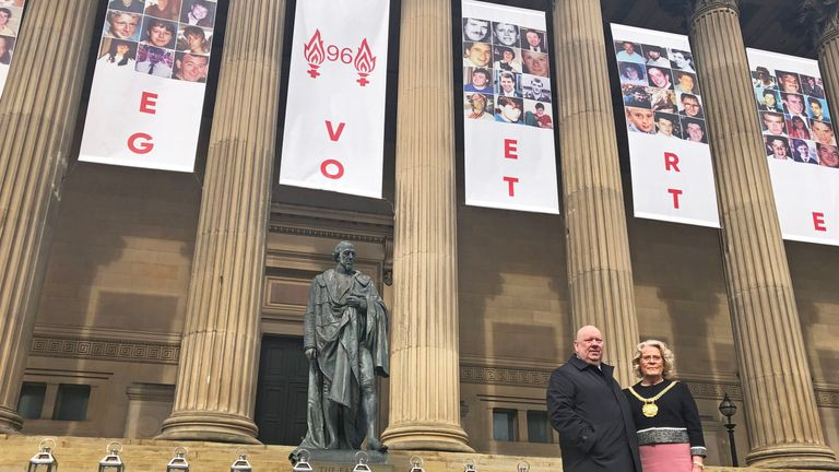 Mayor of Liverpool Joe Anderson and Lord Mayor Christine Banks stand on the steps of St George's Hall in Liverpool after laying wreaths to mark the 30th anniversary of the Hillsborough disaster