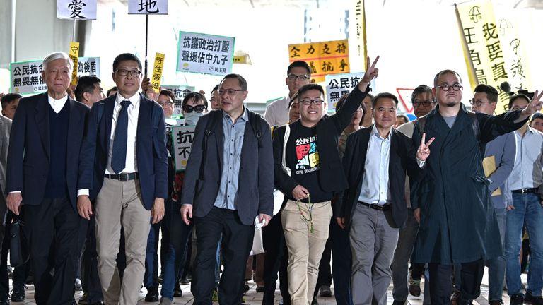 (L-R) Baptist minister Chu Yiu-ming, sociology professor Chan Kin-man, law professor Benny Tai, Raphael Wong, Lee Wing Tat, Shiu Ka Chuen and other pro-democracy campaigners