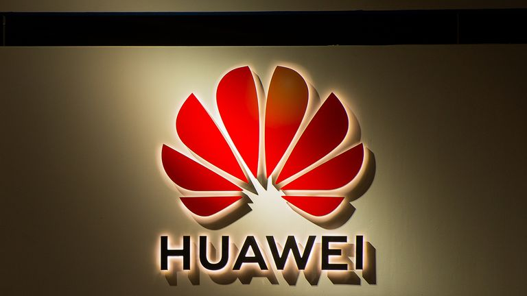 A logo sits illumintated outside the Huawei booth on day 2 of the GSMA Mobile World Congress 2019