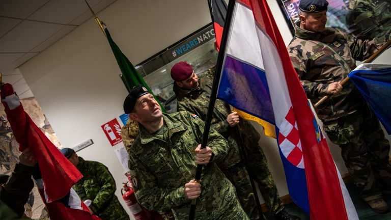 NATO military personnel assemble their nation's flags as they gather in the barracks before the start of the NATO commemorative parade at Imjin Barracks on April 4, 2019 in Gloucester, England. This week NATO turns 70 years old. To celebrate, all 23 nations serving with the UK led NATO headquarters parade under their respective nation's flags at the NATO Allied Rapid Reaction Corps in Gloucester