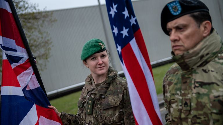 NATO military personnel assemble their nation's flags as they gather in the barracks before the start of the NATO commemorative parade at Imjin Barracks on April 4, 2019 in Gloucester, England