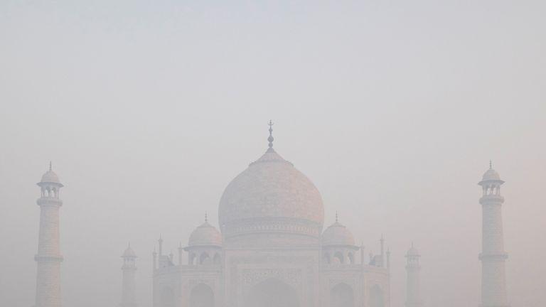 The Taj Mahal through morning air pollution in Agra, India