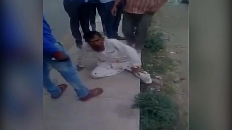Pehlu Khan being beaten by Hindu vigilantes