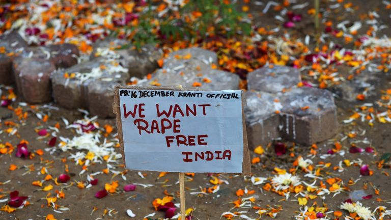 A placard beside a memorial on the second anniversary of the fatal gang-rape of a student in the Indian capital