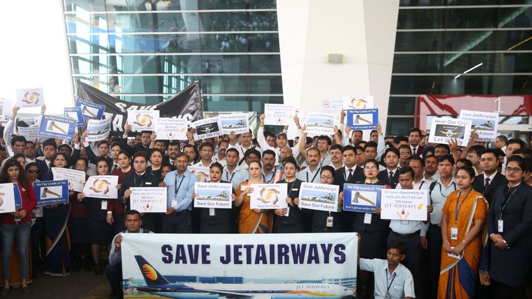 Jet Airways employees hold placards as they gather for a silent march at Terminal 3 of the Indira Gandhi International Airport, in New Delhi on April 13, 2019