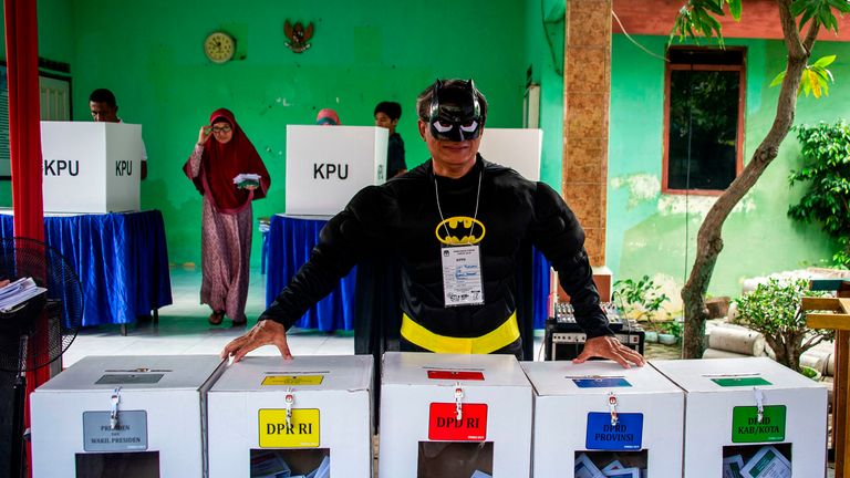An Indonesian election worker dressed as Batman in Surabaya