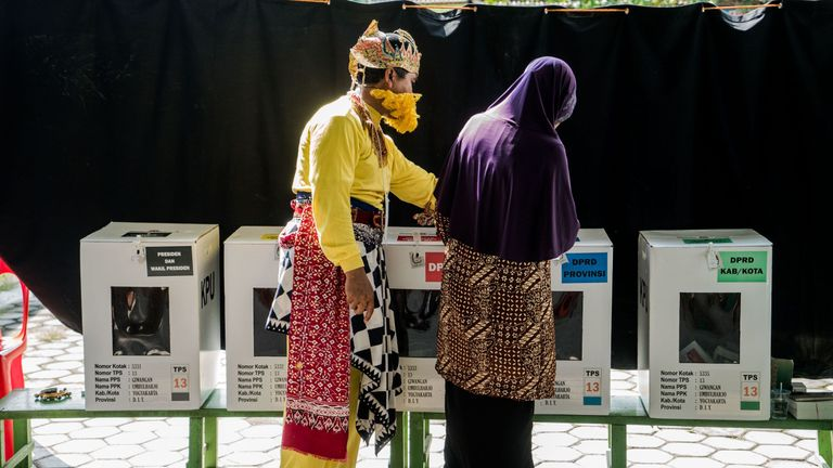 People cast their votes at a polling station in the historic city of Yogyakarta