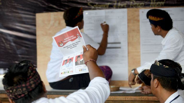 Officials count ballots at a polling centre in Bali