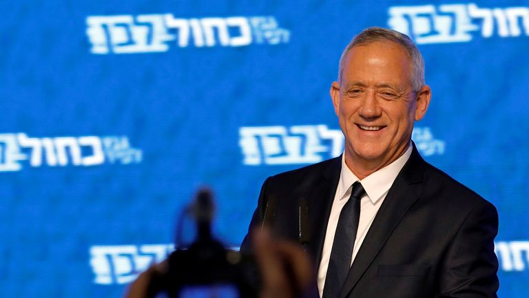 Benny Gantz, head of Blue and White party, smiles as he delivers a speech following the announcement of exit polls in Israel's parliamentary election