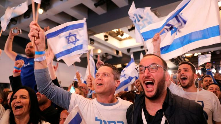 Supporters of the Blue and White party celebrate