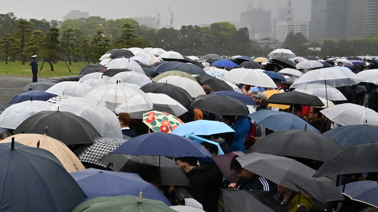 Hundreds stand outside the royal palace in Tokyo as the abdication takes place