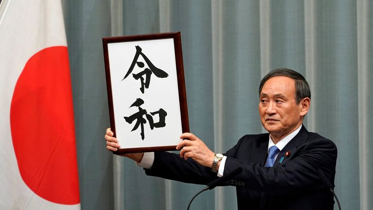 Japan's Chief Cabinet Secretary Yoshihide Suga unveils 'Reiwa' as the new era name