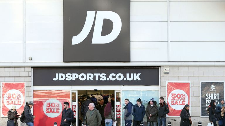 Shoppers visit the Boxing Day sale at a JD Sports store near Wembley stadium, London