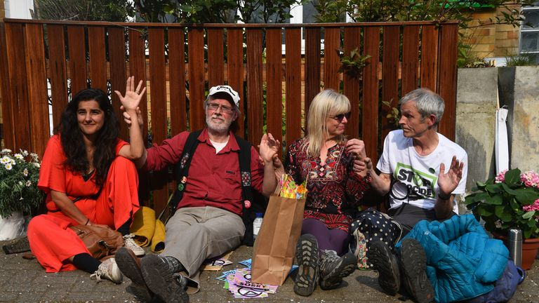 Climate activists who have glued themselves together sit outside Labour Party leader Jeremy Corbyn's house in north London.