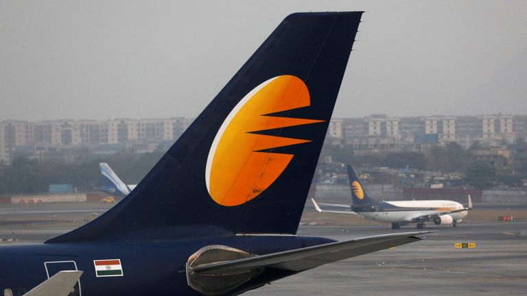 A Jet Airways plane is parked as other moves to runway at the Chhatrapati Shivaji International airport in Mumbai, India, February 14, 2018
