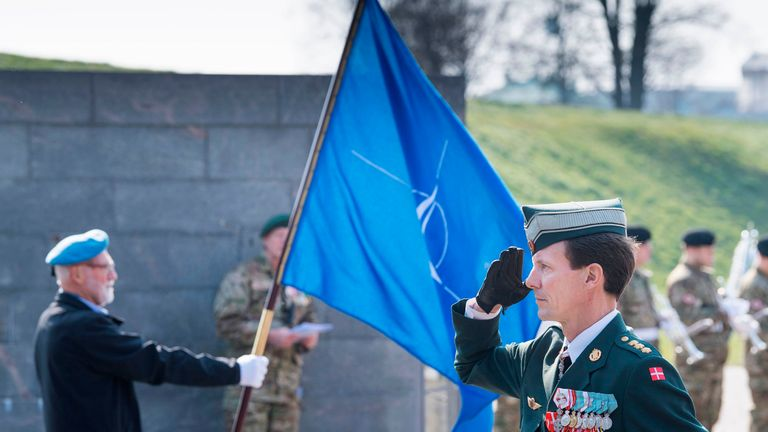 Denmark's Prince Joachim salutes in front of a memorial during a ceremony that marks the 70th anniversary of NATO's creation at Kastellet in Copenhagen on April 4, 2019