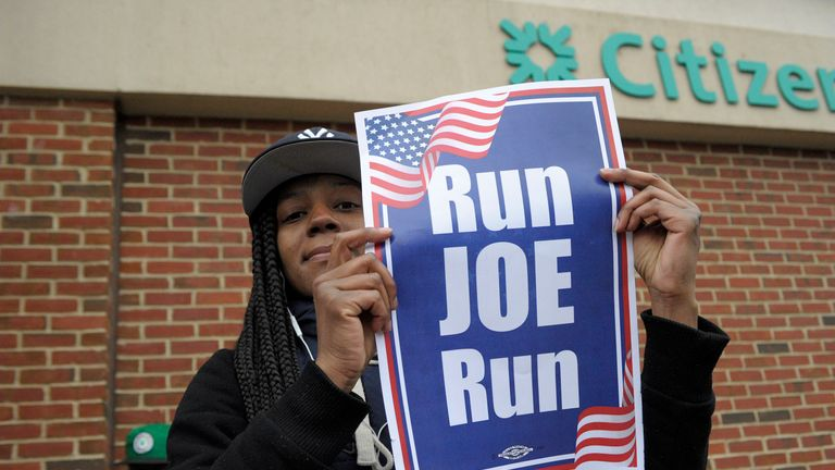 "Jasmin Richardson holds a ""Run Joe Run"" sign after former US vice president Joe Biden spoke at a rally organized by UFCW Union members to support Stop and Shop employees on strike throughout the region at the Stop and Shop in Dorchester, Massachusetts, April 18, 2019. (Photo by JOSEPH PREZIOSO / AFP)        (Photo credit should read JOSEPH PREZIOSO/AFP/Getty Images)"