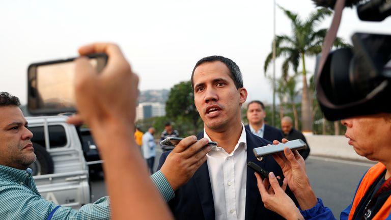 Venezuelan opposition leader Juan Guaido talks to the media outside Generalisimo Francisco de Miranda...