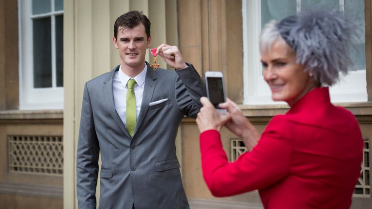 Judy Murray and her son Jamie Murray after he received his OBE in 2016