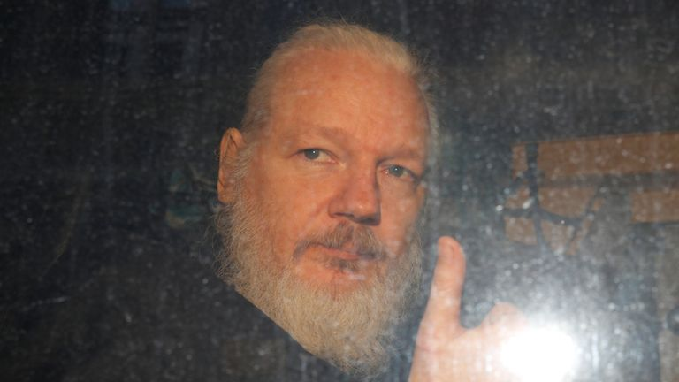 Julian Assange after was arrested by British police outside Westminster Magistrates Court