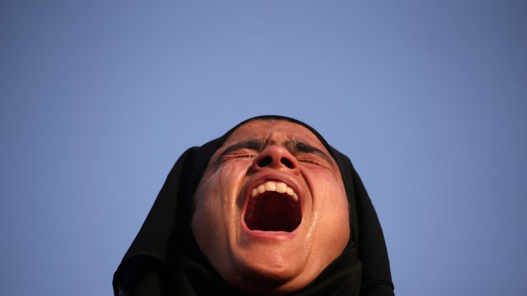 A girl cries as she watches the funeral in Srinagar of a suspected militant  killed by Indian forces
