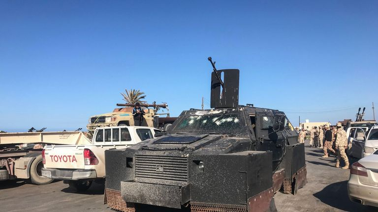 Forces loyal to Libya's UN-backed government arrive in a suburb of the capital Tripoli