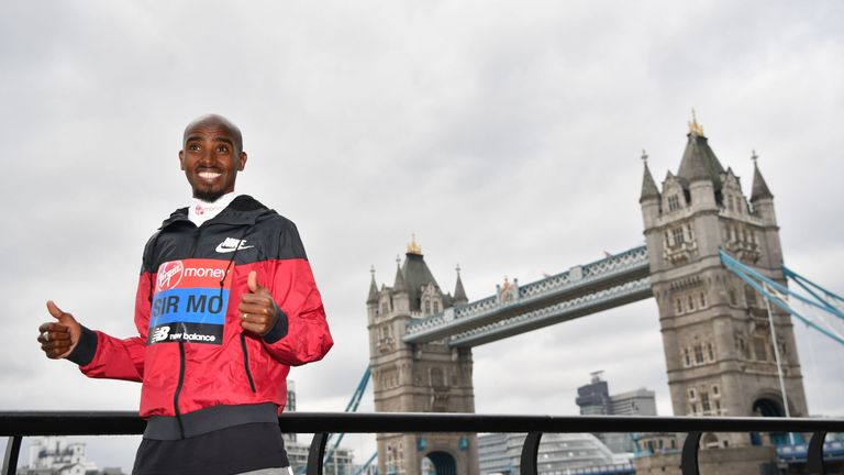 Men's elite runner Britain's Mo Farah poses during a photocall for the London marathon at Tower Bridge in central London on April 24, 2019