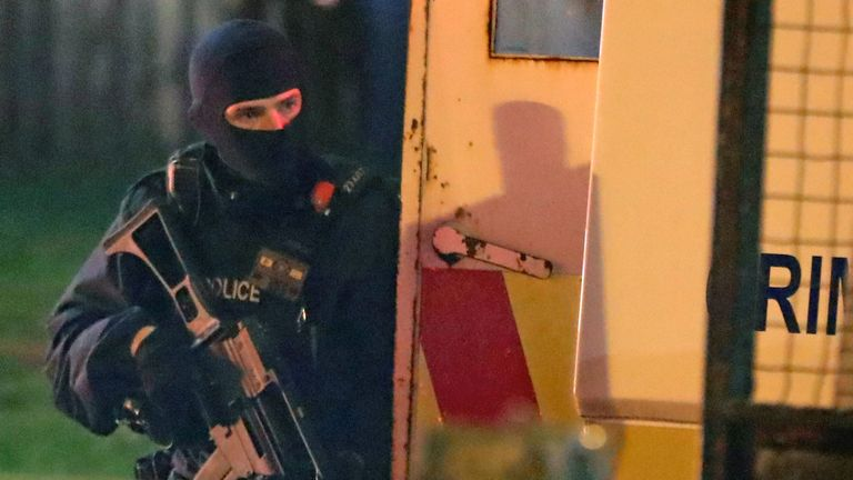 Armed police at the scene of unrest in Creggan, Londonderry. PRESS ASSOCIATION Photo. Picture date: Thursday April 18, 2019. Photo credit should read: Niall Carson/PA Wire