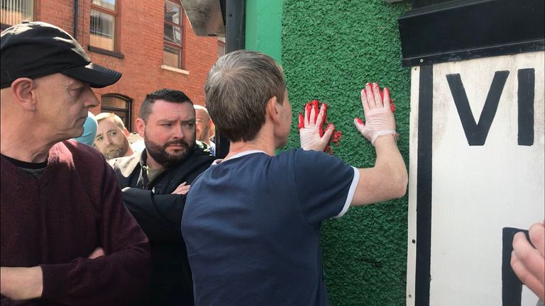 They painted their hands and defaced the office in protest