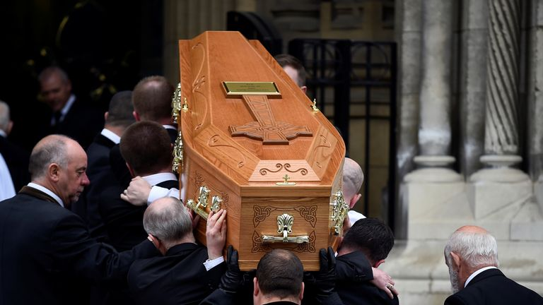 Pallbearers carry the coffin of journalist Lyra McKee at her funeral