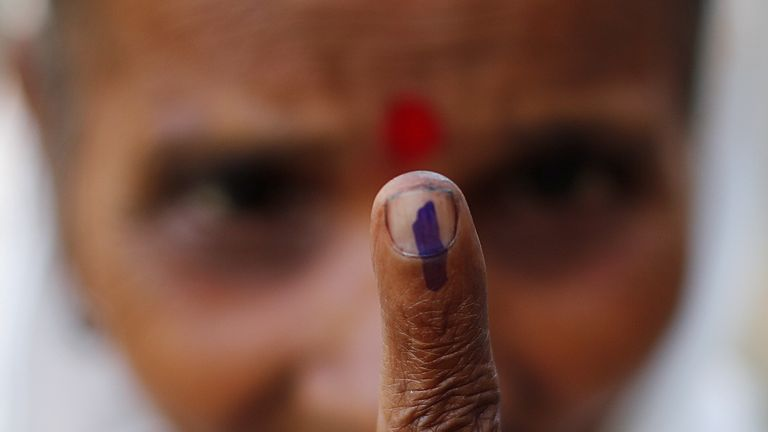 A woman shows her ink-marked finger after casting her vote at a polling station in Majuli, a large river island in the Brahmaputra river, in the northeastern Indian state of Assam, April 11, 2019