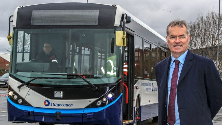 "Stagecoach Group Chief Executive Martin Griffiths with the ""driverless"" bus at the Stagecoach depot in Sharston, Manchester"