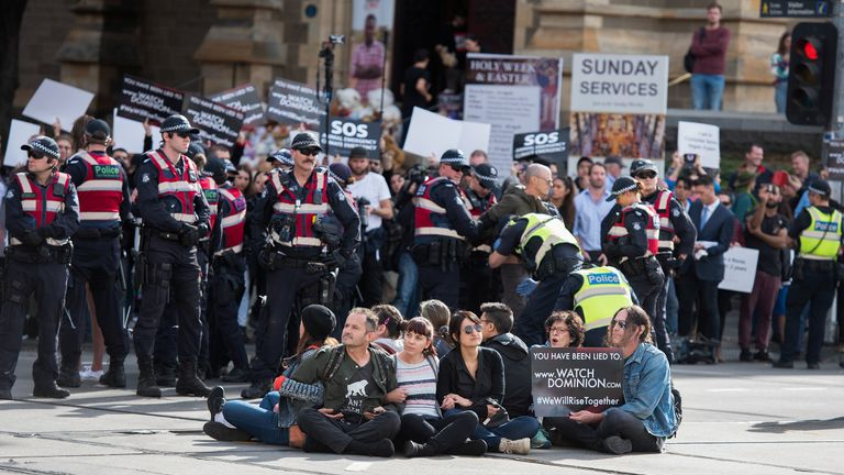 Police move in on animal rights protesters who had blocked the intersections of Flinders and Swanston Street, in Melbourne, Australia, April 8, 2019