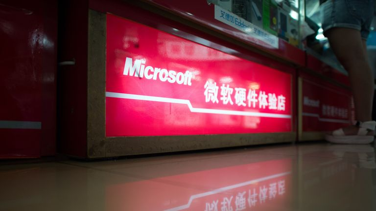 A Microsoft logo is pictured at a electronic store in Shanghai on July 29, 2014. A Chinese probe into Microsoft is probably targeting its 'monopoly ' of the country's operation system market, state media said, after the US software giant became the latest foreign firm ind Beijing's scrutiny. AFP PHOTO / JOHANNES EISELE (Photo credit should read JOHANNES EISELE/AFP/Getty Images)