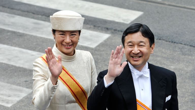 Naruhito (R) and Crown Princess Masako of Japan arrive for a religious ceremony marking the abdication of Queen Beatrix and the investiture of her eldest son Willem-Alexander