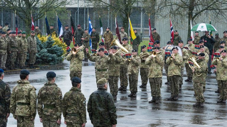 NATO military personnel assemble their nation's flags as they gather in the barracks before the start of the NATO commemorative parade at Imjin Barracks on April 4, 2019. Pic: Allied Rapid Reaction Corps
