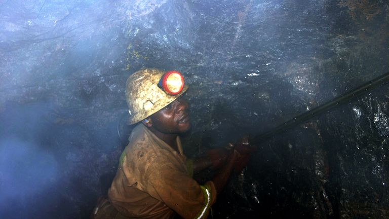 Bright Mutambo, of Konkola Copper Mines PLC, works in Nchanga mine in Cingola, Zambia, April 13, 2005