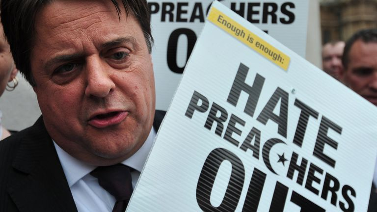 British National Party (BNP) leader Nick Griffin speaks to the media during a demonstration in central London