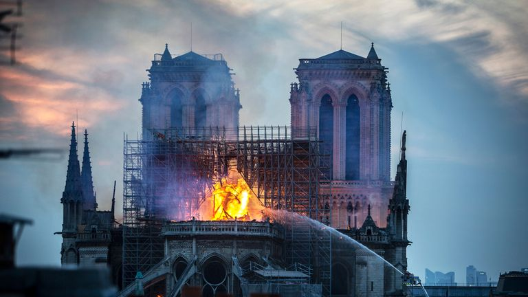 PARIS, FRANCE - APRIL 15: Smoke and flames rise from Notre-Dame Cathedral on April 15, 2019 in Paris, France. A fire broke out on Monday afternoon and quickly spread across the building, collapsing the spire. The cause is yet unknown but officials said it was possibly linked to ongoing renovation work. (Photo by Veronique de Viguerie/Getty Images)
