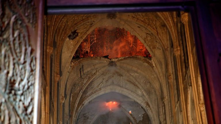 The burning roof of Notre Dame see from inside the cathedral