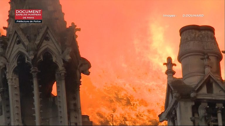 Firefighters film the Notre Dame blaze