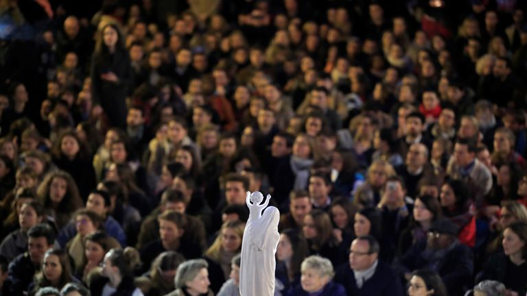 Hundreds of French residents held a vigil, a day after a massive fire engulfed the Notre-Dame cathedral.