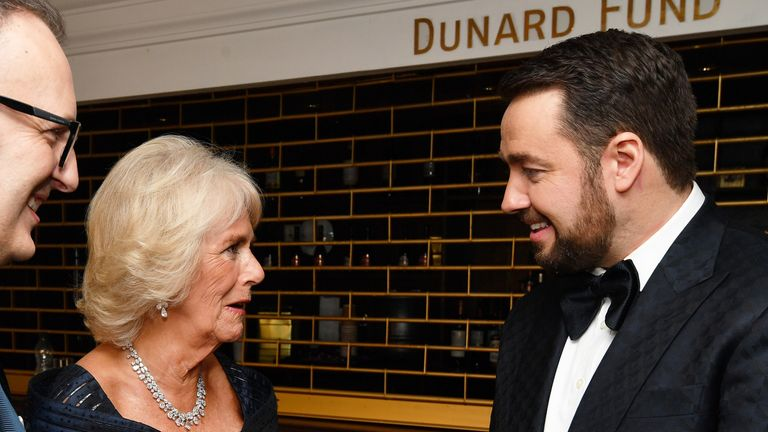 Camilla, Duchess of Cornwall talks to host Jason Manford after attending the Olivier Awards at the Royal Albert Hall on April 7, 2019 in London
