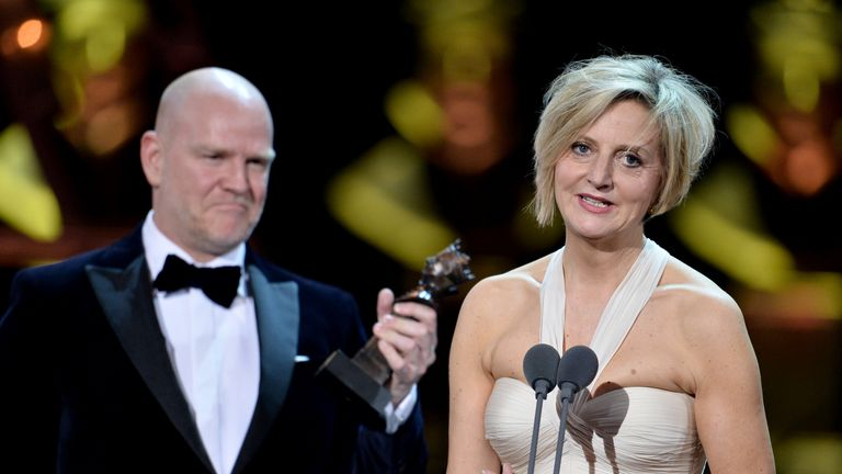 Marianne Elliott and Chris Harper, winners of the Best Musical Revival award for 'Company', on stage during The Olivier Awards at the Royal Albert Hall on April 07, 2019