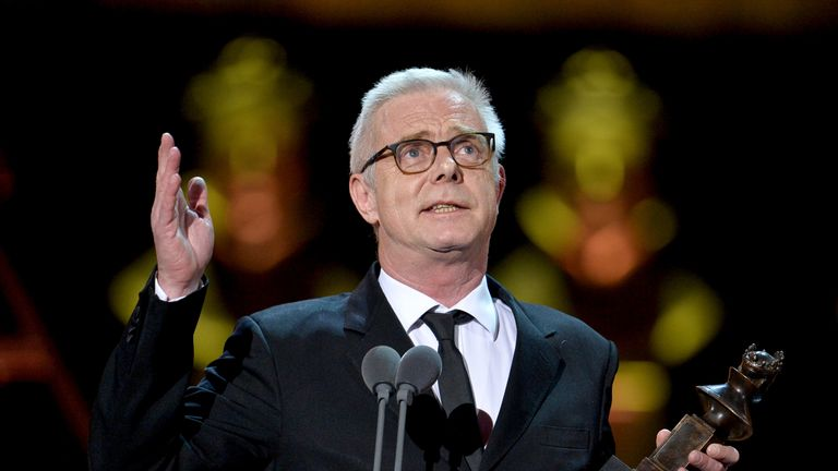 Stephen Daldry accepts the Best Director award on stage during The Olivier Awards 2019 with Mastercard at the Royal Albert Hall on April 07, 2019
