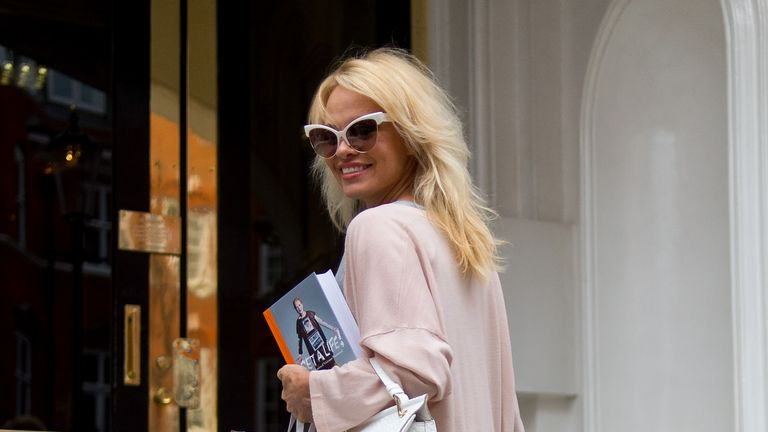 Pamela Anderson delivers lunch to Julian Assange at Embassy of Ecuador