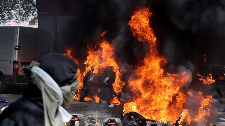 Motorcycles and cars were set on fire as protesters reached Place de la Republique in Paris