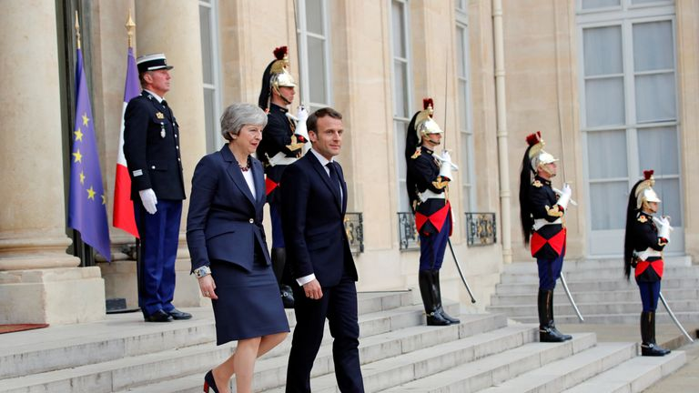 Theresa May leaves her meeting with Emmanuel Macron in Paris
