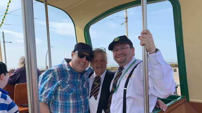 Comedian Peter Kay poses for a photo on a tram in Blackpool